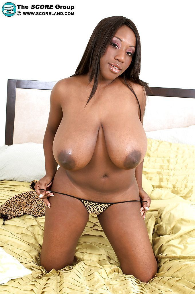 Ebony with big boobs masturbates - Nude photos.