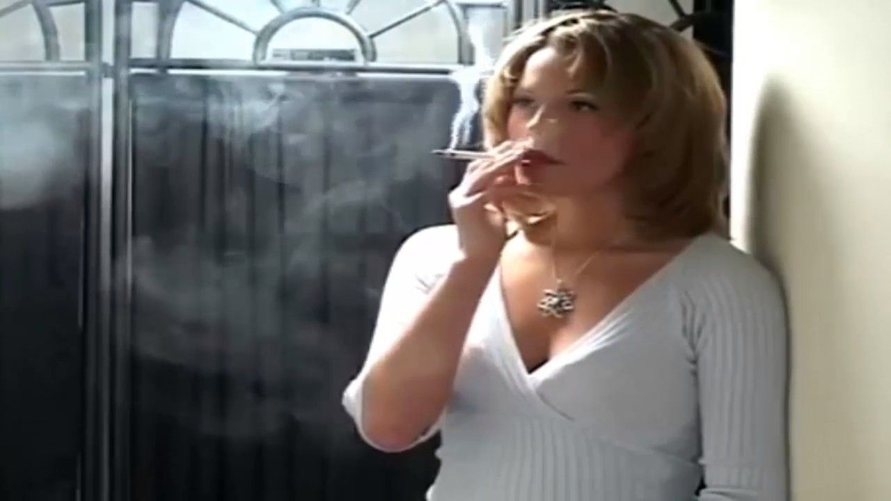Busty cigarette smoking woman